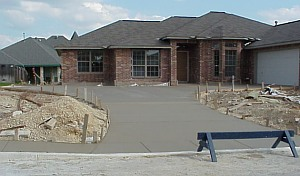 The completed driveway and sidewalk.