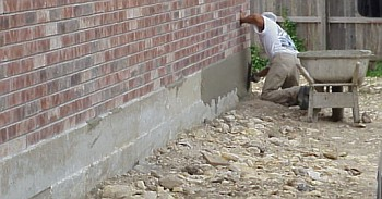 Once the concrete workers have completed the flatwork, they apply a coating to the sides of the foundation to smooth and improve the appearance.