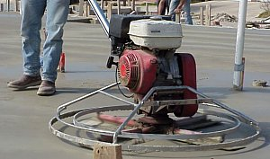 Finally, a power trowel is used to smooth the concrete.